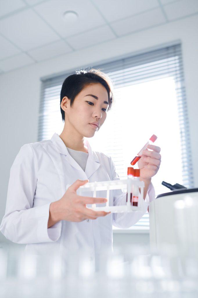 Examining blood sample in lab