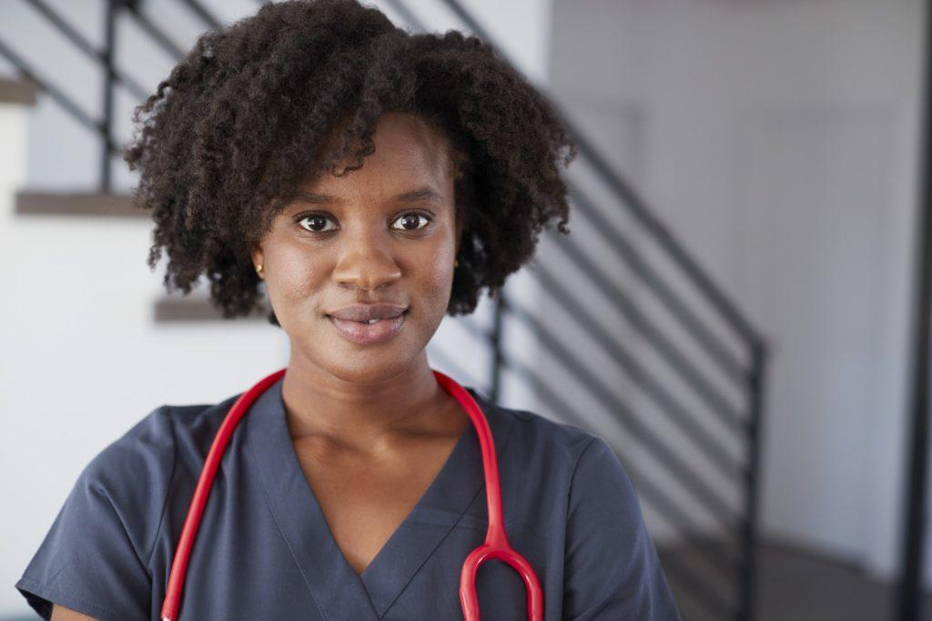 Portrait Of Female Nurse Wearing Scrubs In Hospital